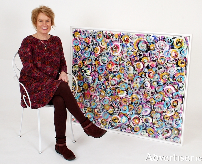 The artist Adrienne M Finnerty with her work Joy Abundance.