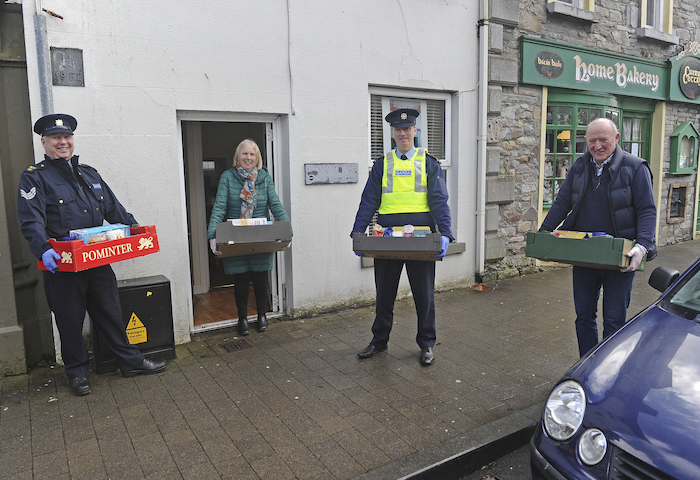 Lending a helping hand: St Vincent De Paul Westport receiving assistance in the delivery of food boxes from local Gardai from the Community Policing Unit. From left: Sgt Kieran McGinty, Marie Ruane, Garda Linus Fahy and Stephen Breheny. Photo:Conor McKeown.