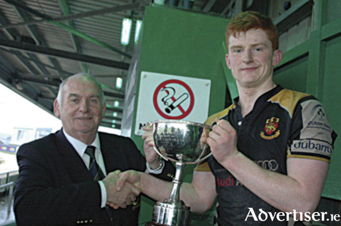 Victorious Buccaneers captain Fergus Galvin is presented with the Connacht U-18.5 Cup by Mossy Moran