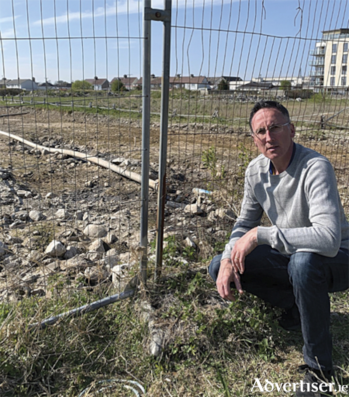 Local Councillor, Aengus O'Rourke, pictured at the scene of a recent sewage spill in an area of special conservation on the banks of the River Shannon in Athlone