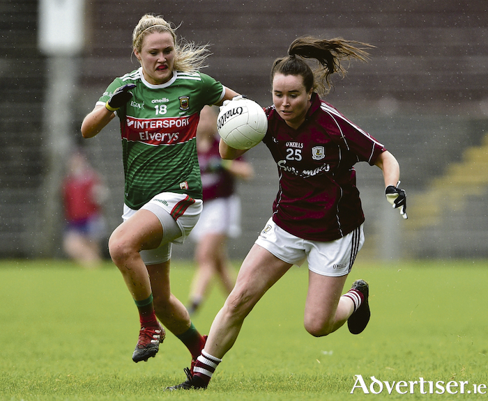 Galway's Nicola Ward , in action against Fiona Doherty of Mayo, is getting back to full fitness while beginning her first job as a nurse in Crumlin.