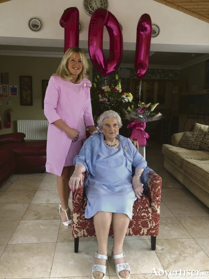 Mary O'Leary pictured with Joan Gardiner Surman, proprietor of the Little Flower Nursing Home in Labane.
