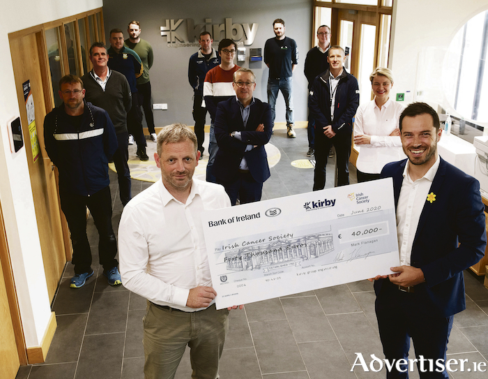 Mikey Ryan, associate director - Connacht business unit leader at Kirby presenting cheque to Adam Abbott, community fundraising manager of the Irish Cancer Society along with Kirby participants of the marathon fundraising.