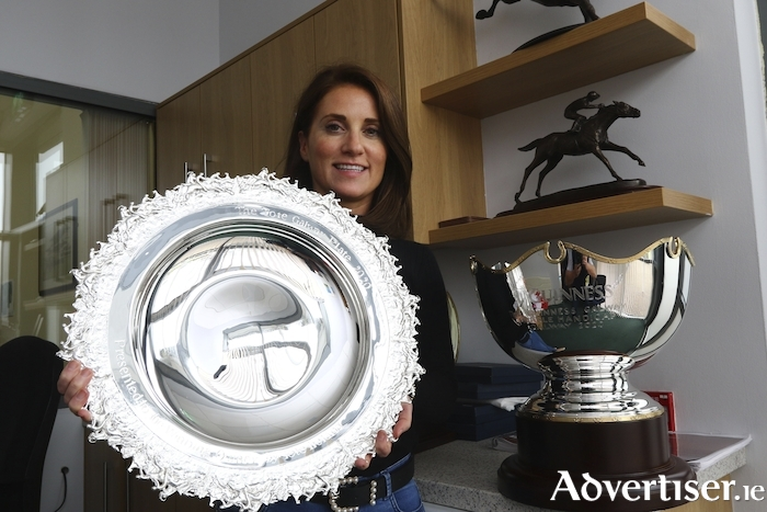 Sinead Cassidy, marketing manager of the Galway Races, with two of the top prizes in Irish Racing The Galway Plate and The Guinness Galway Hurldle. Photo:- Mike Shaughnessy