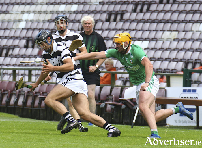 Daniel Loftus of Turloughmore and Kevin Lee of Liam Mellows in action from the Brooks Senior Club Hurling Championship clast at Pearse Stadium on Saturday. Photo:- Mike Shaughnessy