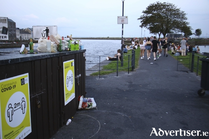 Overflowing litter bins and a crowed quay side on Tuesday evening at the banks of the River Corrib. Photo:- Mike Shaughnessy