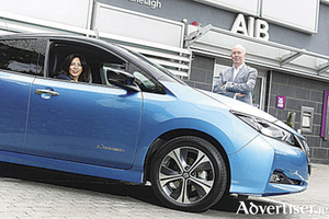 Pictured with the new Nissan Leaf are Yvonne Holmes, chief sustainability officer at AIB, and James McCarthy, CEO Nissan Ireland.
