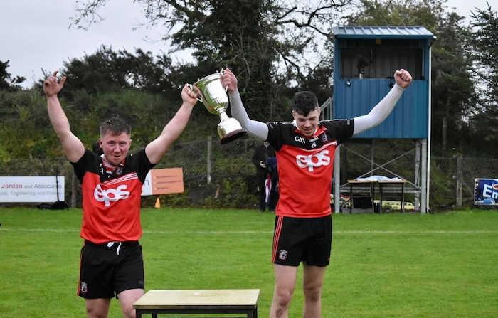 Back in their arms: Ballyhaunis joint captains Adrian Brennan and Kieran Kiely lift the Tyrell Cup. Photo: Ciara Buckley