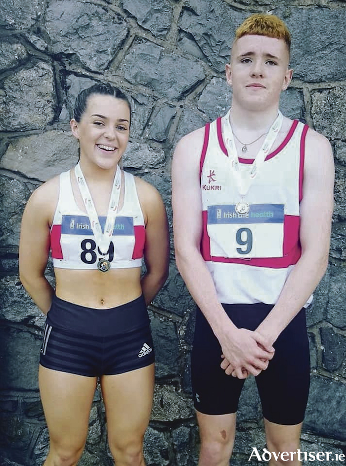 Seren O'Toole and Conor Hoade - winners at the National Track and Field Championships.
