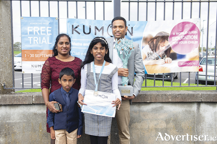Abigail Sunil, maths gold medallist and recipient of the Stephen Hayden Trophy, with her family after the Kumon 2020 Awards ceremony. Photo: Murtography.
