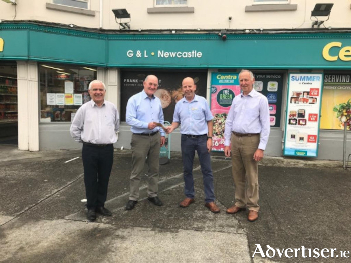 The G & L Store in Newcastle made a contribution to the Newcastle Combined Community Association (NCCA). Photographed from left to right are: Ken Kinneen of G & L Stores presenting a cheque to Seamus Davey, the chairperson of NCCA. Also in the picture is Brendan Beatty, the secretary of NCCA and Martin Divilly, NCCA.
