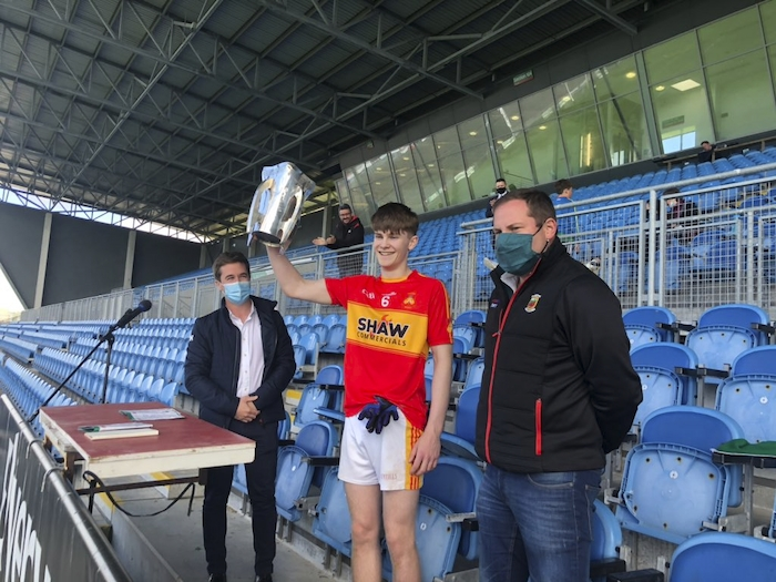 Magic number 19: Castlebar Mitchels captain James Cunningham lifts the Mayo GAA MFC A trophy as his side claimed their 19th title with an impressive display against Ballina. Photo: Mayo GAA