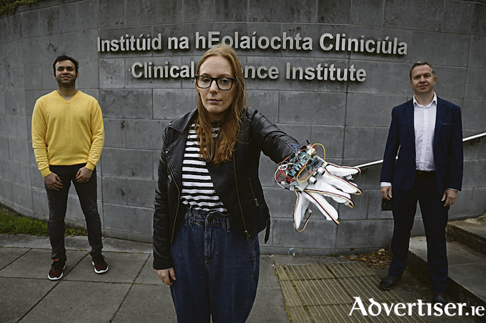Sinead Hanrahan, from Loughrea, Co Galway, trialling the JediGlove prototype. (Left-right Professor Derek O'Keeffe, Sinead Hanrahan, and Mouzzam Hussain). Photograph by Aengus McMahon.