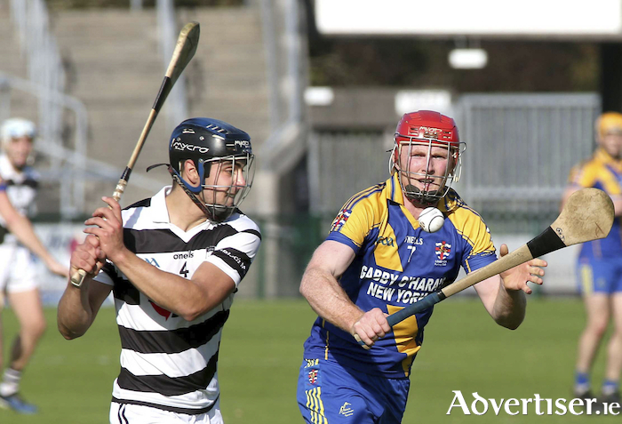 Turloughmore's Daniel Loftus and Loughrea's Sean Sweeney in action during the Senior Hurling Championship semi -final at Pearse Stadium. Photograph: Mike Shaughnessy