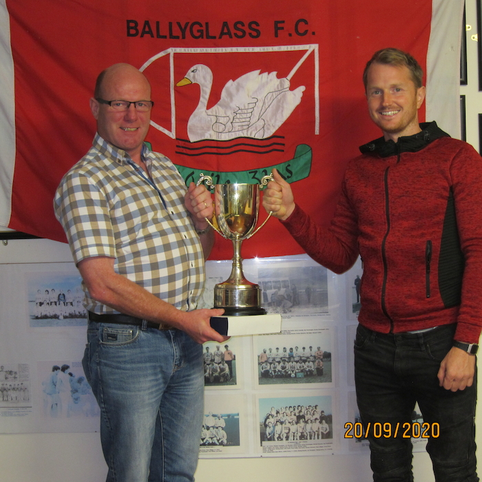 Charlie O'Malley, Clubperson of the Year, Ballyglass FC, receives the Martin Moran Memorial Cup from Club Chairman, Darren Reilly,