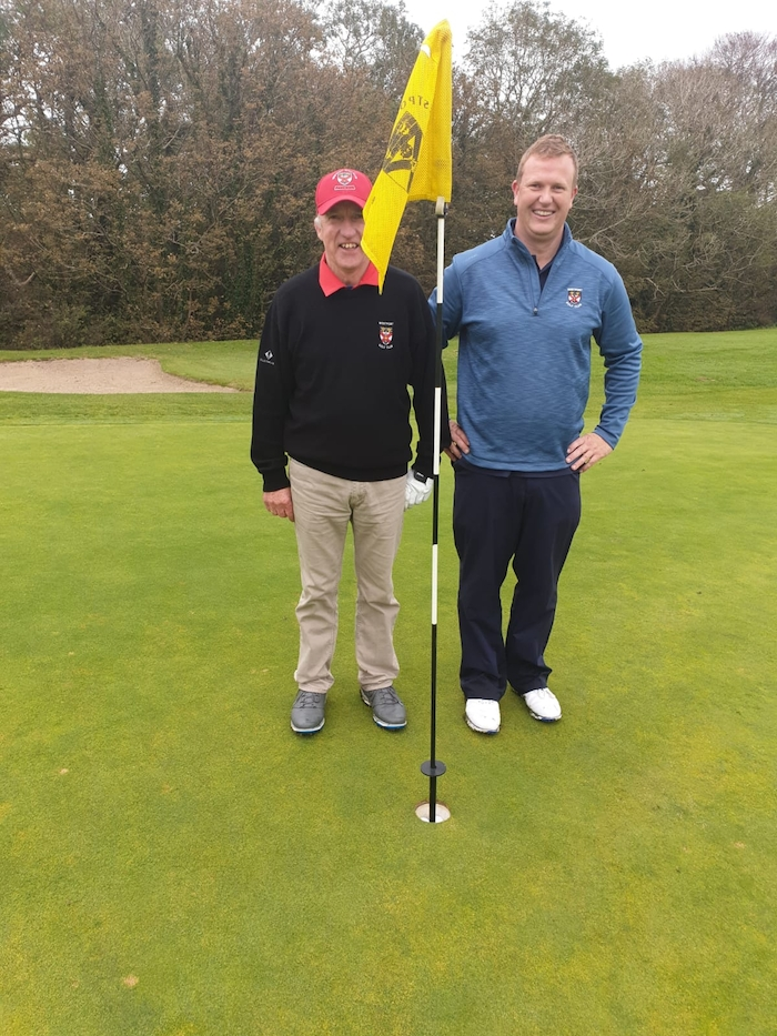 Second shots: Eugene Lavelle and Ronan Heir pictured after they both holed their second shots on the 13th hole at Westport Golf Club last Sunday.