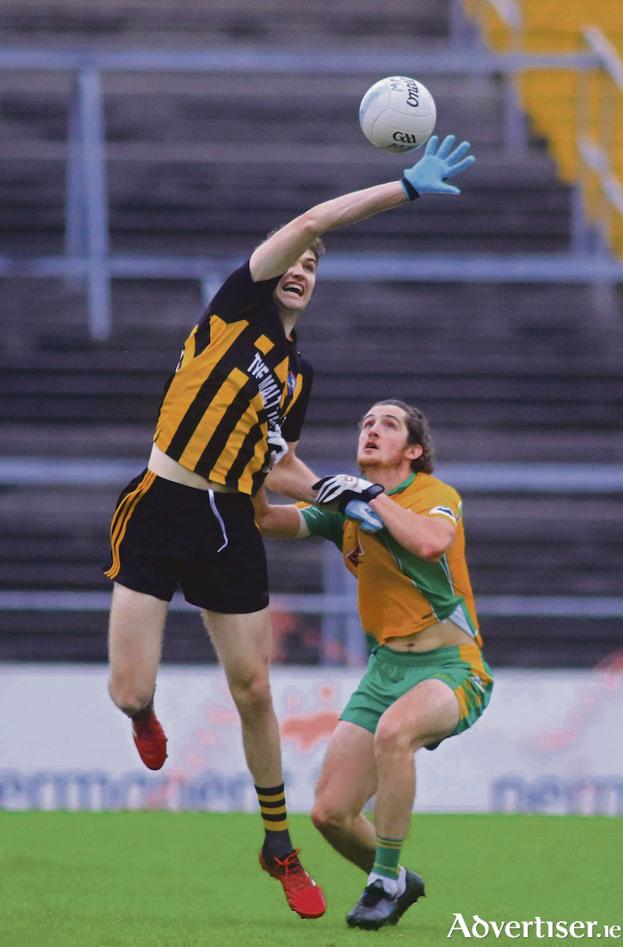 Reaching High Mountbellew / Moylough's Eoin Finnerty and Corofin's Kieran Molloy in action from the Galway Country Senior Football semi final at P