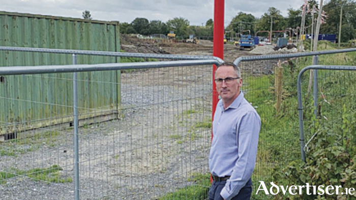 Town Mayor, Cllr. Aengus O'Rourke, pictured on the site of the former Showgrounds