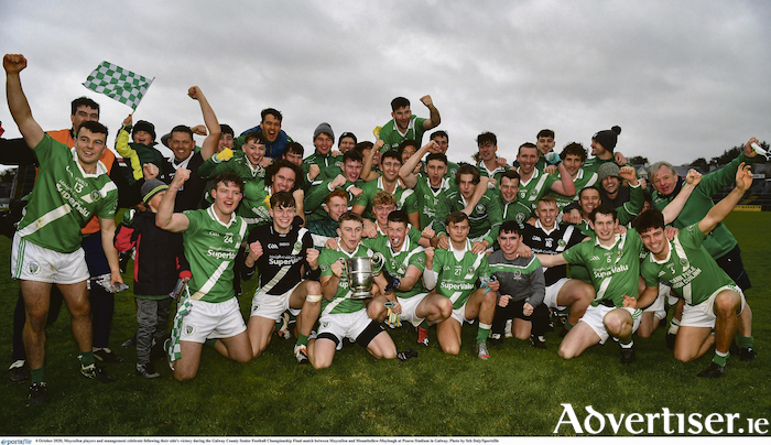 Moycullen players and management celebrate following their side's victory over Moycullen and Mountbellew-Moylough in the Galway County Senior Football Championship final at Pearse Stadium in Galway.       Photo: Seb Daly/Sportsfile