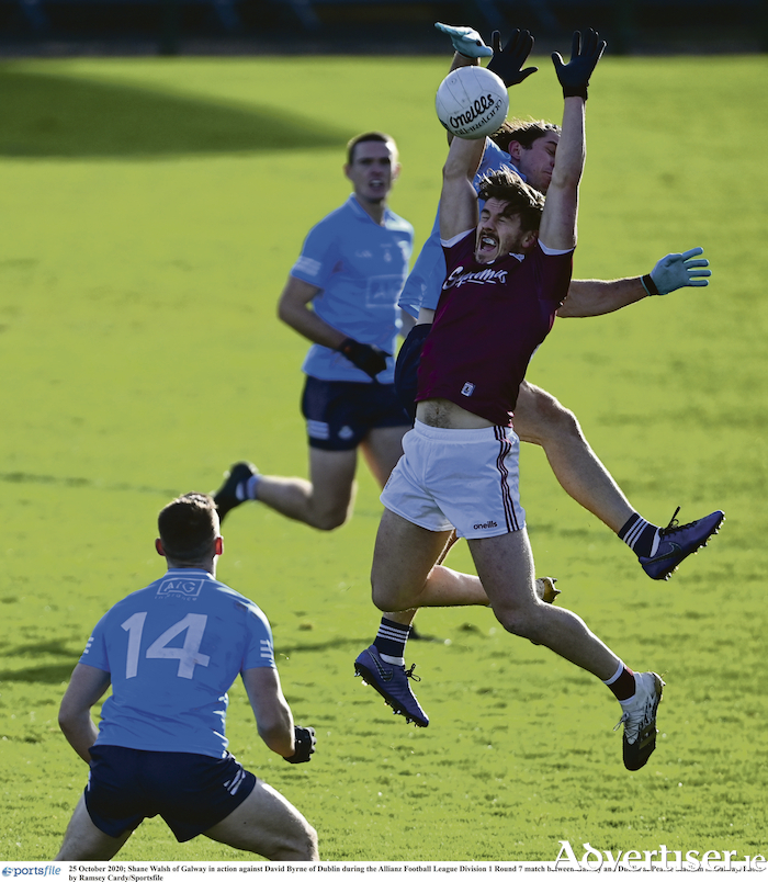Shane Walsh of Galway surrounded by Dublin players during the Allianz Football League match  at Pearse Stadium in Galway. Photo:  Ramsey Cardy/Sportsfile