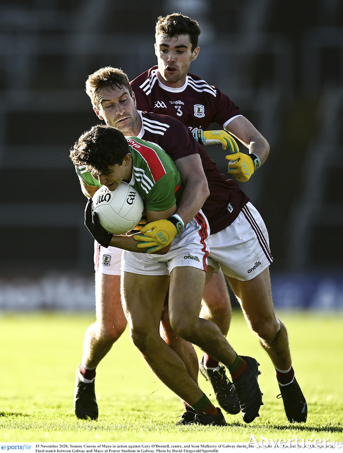 Trying to get to grips with Mayo's Tommy Conroy are Galway's Gary O'Donnell, centre, and Sean Mulkerry during the Connacht Senior Football Championship final at Pearse Stadium in Galway.                 Photo:  David Fitzgerald/Sportsfile