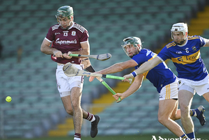 Brian Concannon of Galway in action against Cathal Barrett and Brendan Maher of Tipperary in the All-Ireland Senior Hurling Championship quarter-final against  Tipperary at LIT Gaelic Grounds in Limerick. Photo by Piaras  Mcdheach/Sportsfile