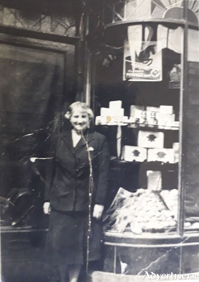 Dorinda Holland outside the Williamsgate Street shop in 1938.