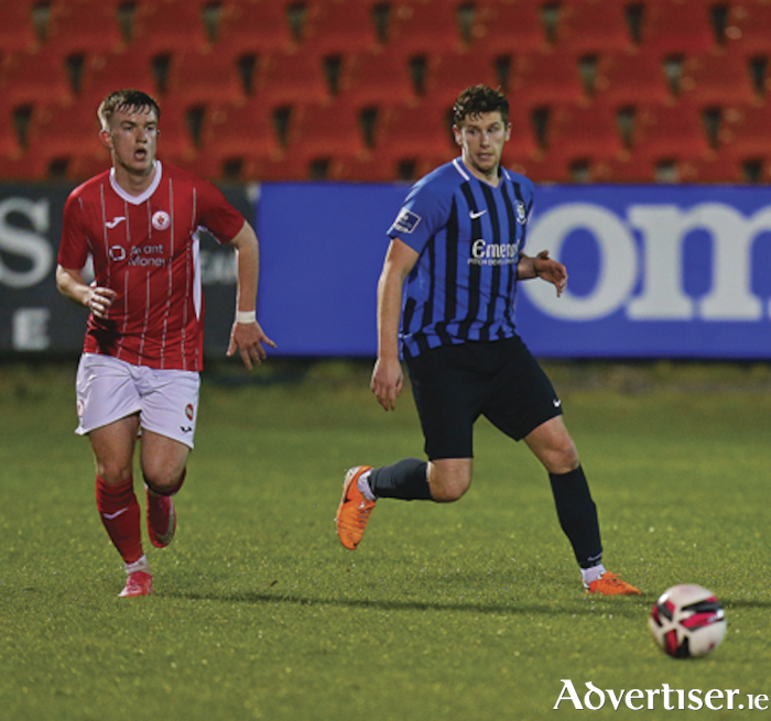Athlone Town goal scorer Jamie Hollywood gets to the ball ahead of Sligo's Darren Collins during Mondays pre-season defeat at The Showgrounds.  Photograph by AC Sports Images.