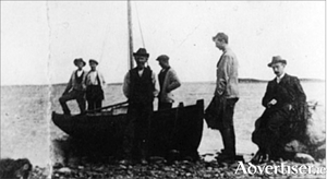Summers on Tawin: de Valera with boatmen on the beach at Tawin Island (photo taken from Diarmaid Ferriter's Judging Dev).