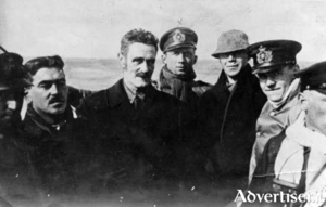 Roger Casement (centre) looking ill, with Captain Karl Spindler and other crewman, both in Norwegian disguise, about to leave the Baltic port  of Lubeck. Casement, Monteith and Bailey followed  in a submarine.