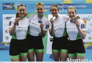 11 April 2021; Ireland rowers, from left, Aifric Keogh, Eimear Lambe, Fiona Murtagh and Emily Hegarty celebrate with their silver medals after the Women's Four A Final during Day 3 of the European Rowing Championships 2021 at Varese in Italy. 