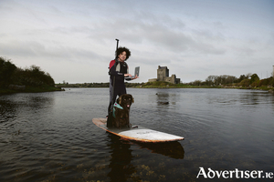 Thriving through Digital Transformation will be the theme of Atlantec Festival looking at Cloud, Future of Work, Emerging Tech, Digital Transformation, FinTech, MedTech, Insider Voices and Cyber. Ian Walsh with  Mena from Wet Mongrel Adventures is pictured booking his Atlantec place online while supping near DunGuaire Castle,  Kinvara, Galway.