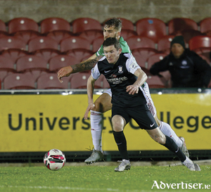 Athlone Town goal scorer, James Doona, gets away from Cork City captain, Gearóid Morrissey, during Friday's LOI First Division encounter in Turners Cross.  Photograph by AC Sports Images.