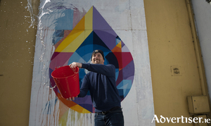 Changing States, a new Athenry Street Mural by artist Shane O'Malley (pictured) that changes colour depending on the weather. Photo: Andrew Downes xposure