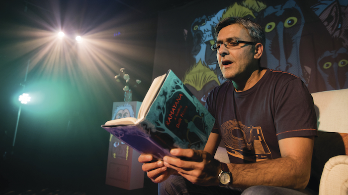 Daljit Nagra sitting reading