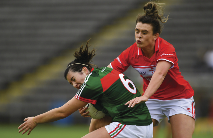 In where it hurts: Rachel Kearns holds on to possession under pressure against Cork. Photo: Sportsfile.