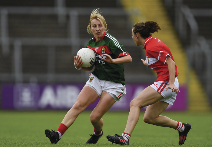 Driving on: Marie Corbett for Mayo drives clear with the ball. Photo: Sportsfile